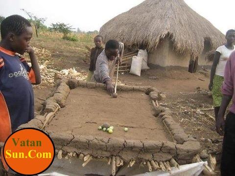 عکسی جالب از بازی بیلیارد در آفریقا