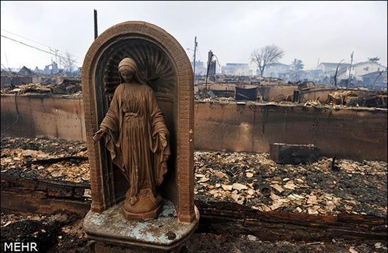 231878 203 طوفان سندی همه چیز را خراب کرد بجز مجسمه مریم مقدس + عکس
