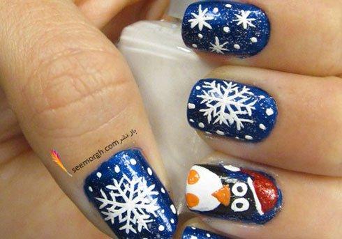 طراحی ناخن برای کریسمس به شکل دانه های برف با رنگ آبی