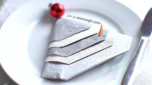 تزیین دستمال سفره به شکل درخت با دستمال کاغذی و منجوق برای کریسمس