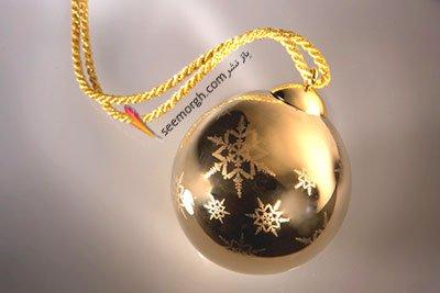 آویز گرد طلایی ورساچه Versace برای کریسمس