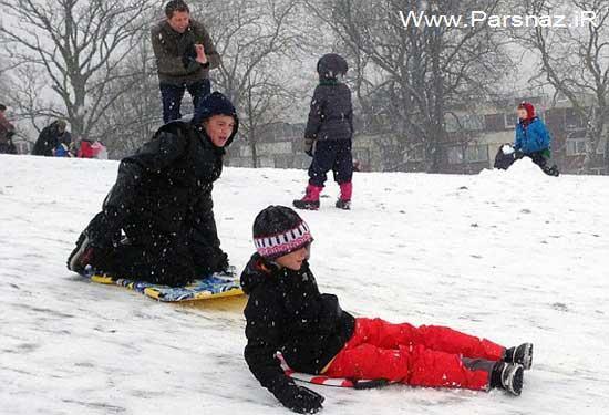 عکس های دیوید بکهام و پسرانش در حال برف بازی